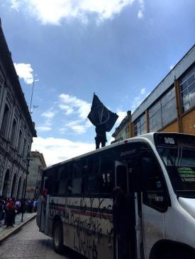 A bus serves as a barricade in the historic city center of Oaxaca.