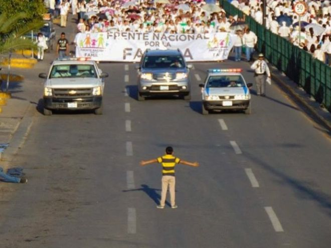 Twelve year old blocks a homophobic march in Guanajuato.